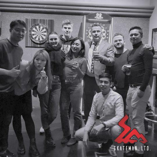 Black and white photo of Skateman team during New Year's dinner