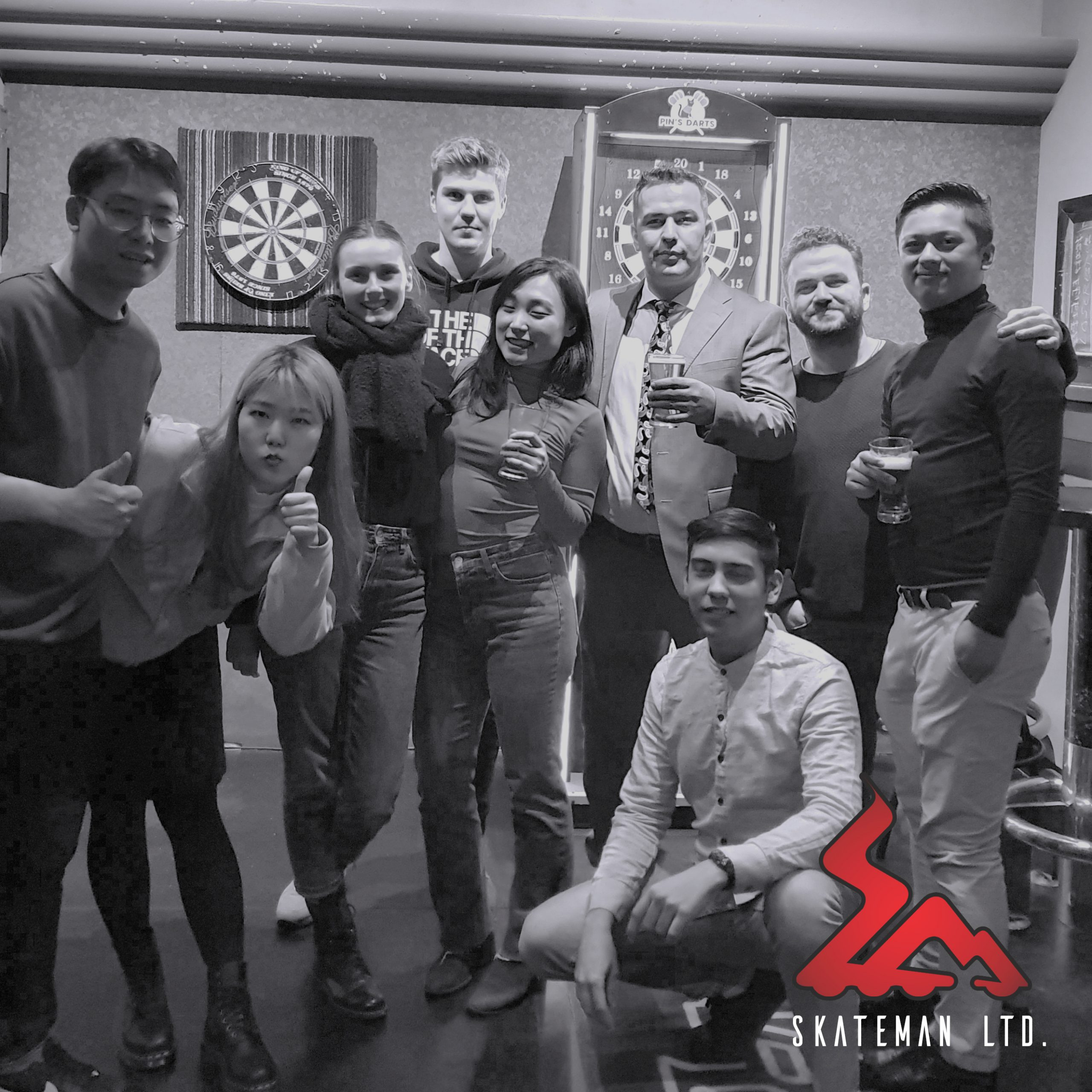 Black and white photo of Skateman team during New Year's dinner
